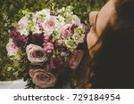 bride holding her boho wedding ... | Shutterstock . vector #729184954