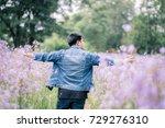Men Are Walking In A Flower...