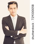 Small photo of Successful ambitious Asian businessman in suit