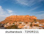 Blue residential houses at the base of Mehrangarh Fort in Jodhpur, Rajasthan.  Large area for copy space. - stock photo