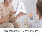 speech therapist in beige... | Shutterstock . vector #729454219
