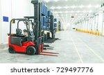 warehouse freezer forklift  | Shutterstock . vector #729497776