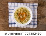 chicken soup with noodles and... | Shutterstock . vector #729552490