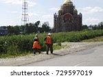 Workers In Orange Overalls
