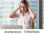surprised businesswoman looking ... | Shutterstock . vector #729605266