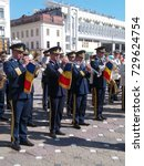 Small photo of TIMISOARA, ROMANIA - OCTOBER 1, 2017: Outdoor public performance at the Fanfare Band Festival, with the Fanfare of the Timisoara Military Garrison in the foreground.