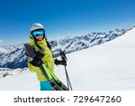 happy young woman skier... | Shutterstock . vector #729647260