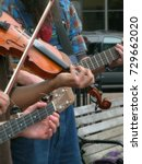 Small photo of Fiddling Hands of Street Buskers in Downtown Asheville