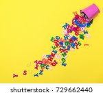 scattered wooden multicolored...   Shutterstock . vector #729662440