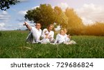 family is resting on the lawn | Shutterstock . vector #729686824