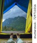 scenic view lying in tent... | Shutterstock . vector #729711016