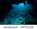 light filters into a dark ... | Shutterstock . vector #729722158