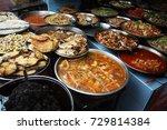 assortment of asian dishes | Shutterstock . vector #729814384