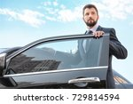 handsome man in suit getting in ... | Shutterstock . vector #729814594