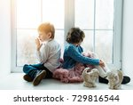 boy and girl sitting at the... | Shutterstock . vector #729816544