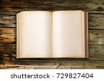 old antique book on wooden table | Shutterstock . vector #729827404