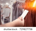 asian girl looking at the price ... | Shutterstock . vector #729827758