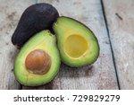 avocado on a dark wood... | Shutterstock . vector #729829279
