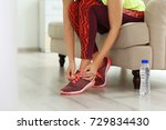 young sporty woman tying... | Shutterstock . vector #729834430