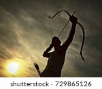 The Silhouette Of An Archer...
