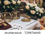 golden crowns and bible and... | Shutterstock . vector #729876640