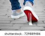 foot stuck into chewing gum on... | Shutterstock . vector #729889486