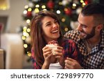 cheerful couple with gift in... | Shutterstock . vector #729899770