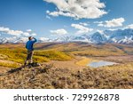 a man looking at the mountains... | Shutterstock . vector #729926878