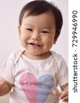 asian baby wearing white...   Shutterstock . vector #729946990