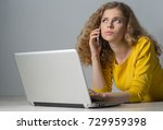 young woman with laptop on gray ...   Shutterstock . vector #729959398