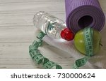 two dumbbells  bottle of water  ... | Shutterstock . vector #730000624