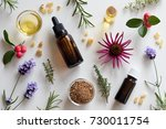 bottles of essential oil with... | Shutterstock . vector #730011754