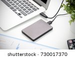 external backup disk hard drive ... | Shutterstock . vector #730017370