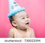 asia baby boy wearing birthday... | Shutterstock . vector #730023394