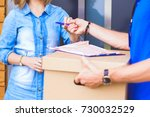 smiling delivery man in blue...   Shutterstock . vector #730032529