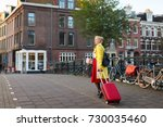 the tourist with suitcase is... | Shutterstock . vector #730035460