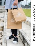 Small photo of NAKHON PATHOM, THAILAND - SEPTEMBER 30, 2017:Bag adidas,Adidas AG headquartered in Herzogenaurach, Bavaria, Germany is the largest sportswear manufacturer in Europe and the second biggest in the world