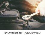 hands of car mechanic in auto... | Shutterstock . vector #730039480