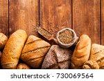 bread on wooden table. | Shutterstock . vector #730069564
