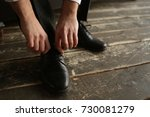 the man ties up the shoelaces | Shutterstock . vector #730081279