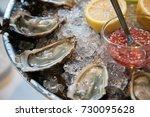 fresh oysters platter on a plate   Shutterstock . vector #730095628