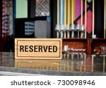 reserved sign on top of a... | Shutterstock . vector #730098946