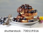pancakes with blueberries and... | Shutterstock . vector #730119316