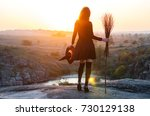 woman in a witch costume with a ... | Shutterstock . vector #730129138