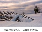 Fallen Wooden Fence On Snowy...