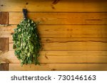 birch brooms on a wooden wall...   Shutterstock . vector #730146163