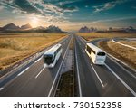 white buses driving towards the ... | Shutterstock . vector #730152358