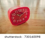 red rectangle alarm clock on