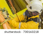 working at height. a commercial ...   Shutterstock . vector #730163218