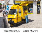 Small photo of Lisbon, Portugal - August 12, 2017: Yellow Piaggio Ape three-wheeled light commercial vehicle as a touristic attractions ticket office